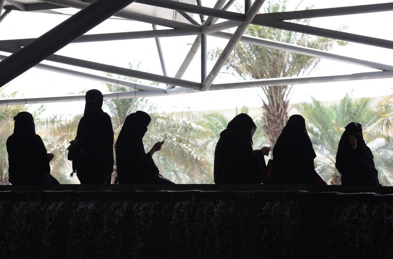 Saudi women wait for their drivers outside a hotel in the Saudi capital Riyadh, on September 28, 2017.
