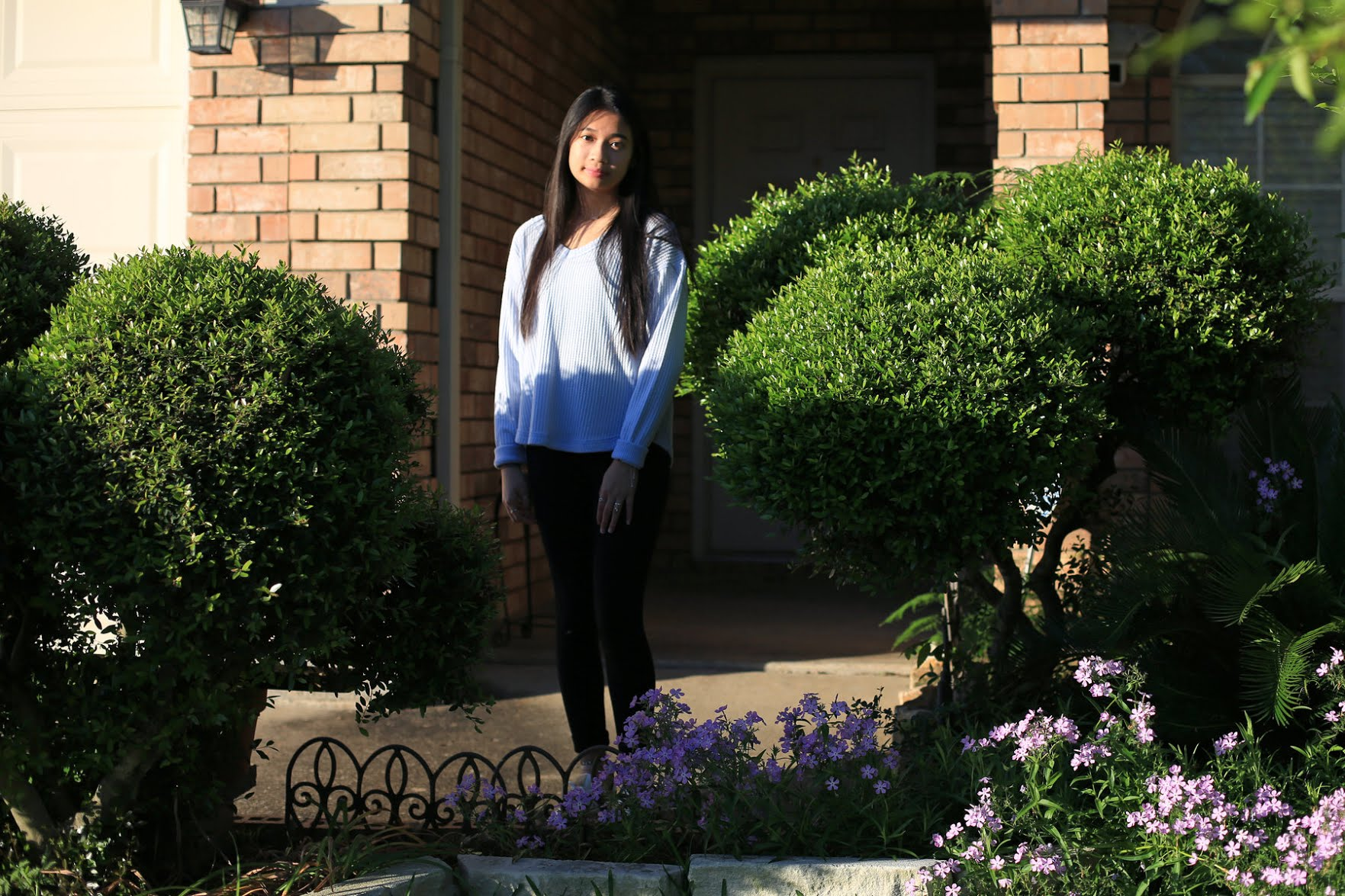 Mary Nguyen of Arlington, Texas, is one of many high school seniors who changed their college plans to stay closer to home.